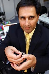 Mark Humayun with the Argus II artificial retina implant. (Photo/Jon Nalick)