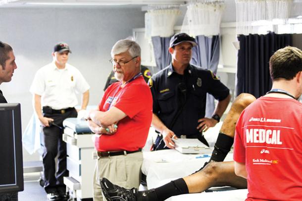 Edward Newton, MD, interim chair at LAC+USC, talks with Kevin Hardiman, DO, chief resident, inside a marathon medical station.