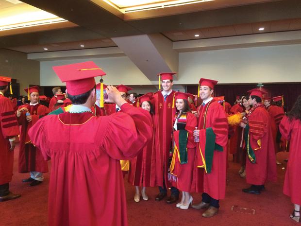 Prior to the commencement procession, Kevin Platt snaps a photo of classmates Allison Woo, Grant Meyer, Amanda Sandoval and Ryan Kobayashi.