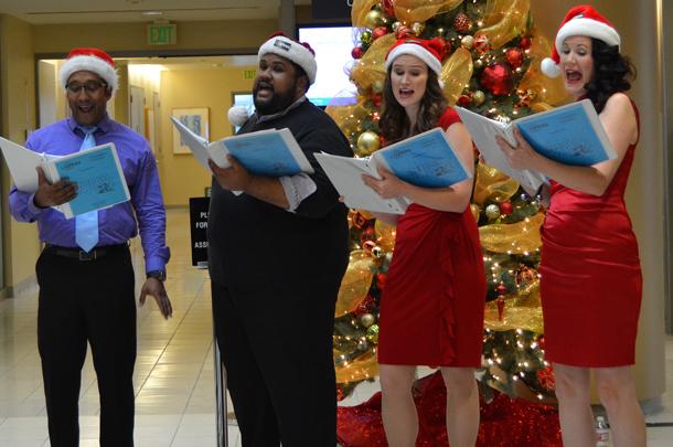 Baritone LeRoy Villanueva, tenor Ashley Faatoalia, mezzo-soprano Melissa Treinkman and soprano Lisa Eden sing Christmas carols.