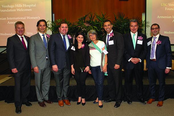 Keck Medicine of USC doctors stand with Silva Katchiguian, president of the Armenian International Women's Association —Los Angeles Chapter.