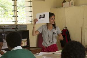 Global medicine alumna Rasa Rafie conducts a classroom activity to understand children's baseline knowledge of nutrition in the Fijian village of Solevu. (Photo/Courtesy Evan Schell)