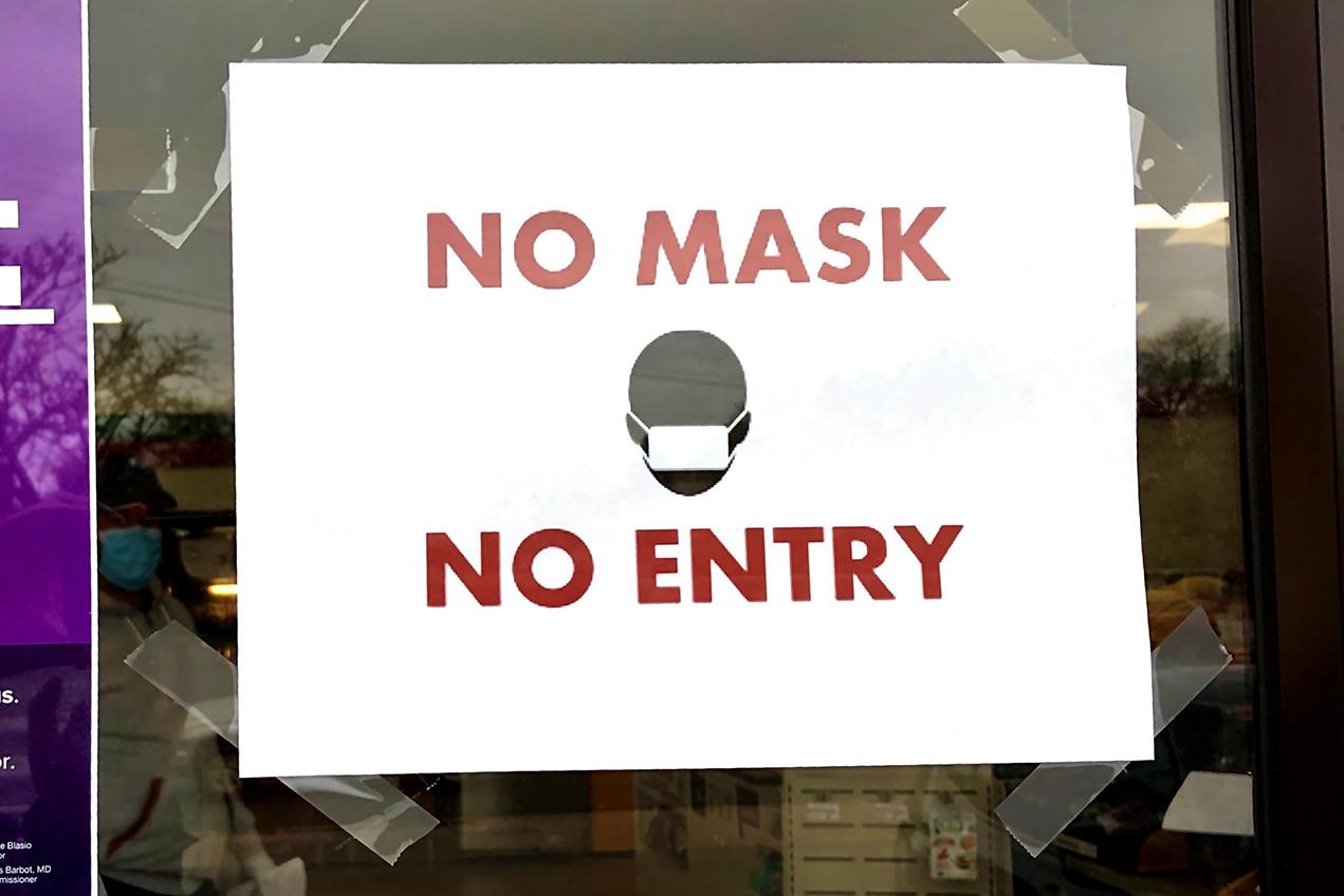 A sign says No Mask, No Entry